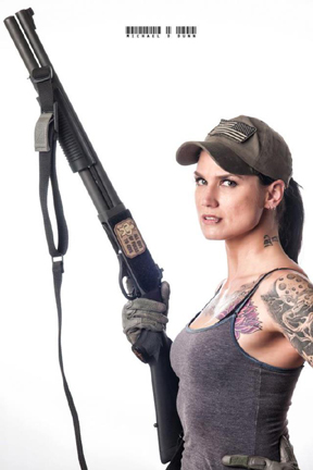 Hot tattooed chick Kassi Kerry, Combat Club girl and model, getting ready to go shooting.
