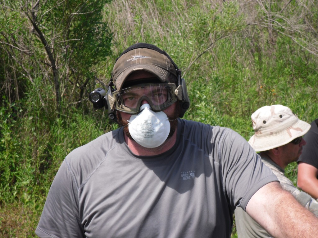 Fisher being a dick while wearing a mask. The mask was to keep him from inhaling glass dust while firing through windshields. He used to not wear a mask during training, so he inhaled a lot of glass, which made him a dick.