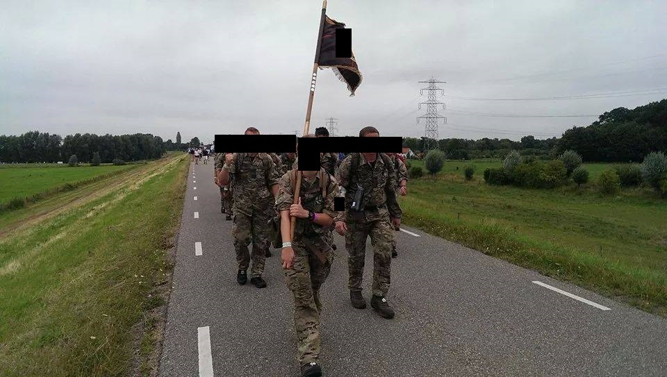 Mary carrying her company's guideon on the Nijmegen March, a 4-day, 160 km road march commemorating Operation Market-Garden in Holland