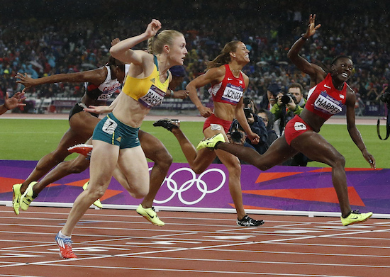 Australia's Sally Pearson crosses the finish line ahead of Dawn Harper of the U.S. and Lolo Jones of the U.S. during their competes in the women's 100m hurdles final during the London 2012 Olympic Games at the Olympic Stadium