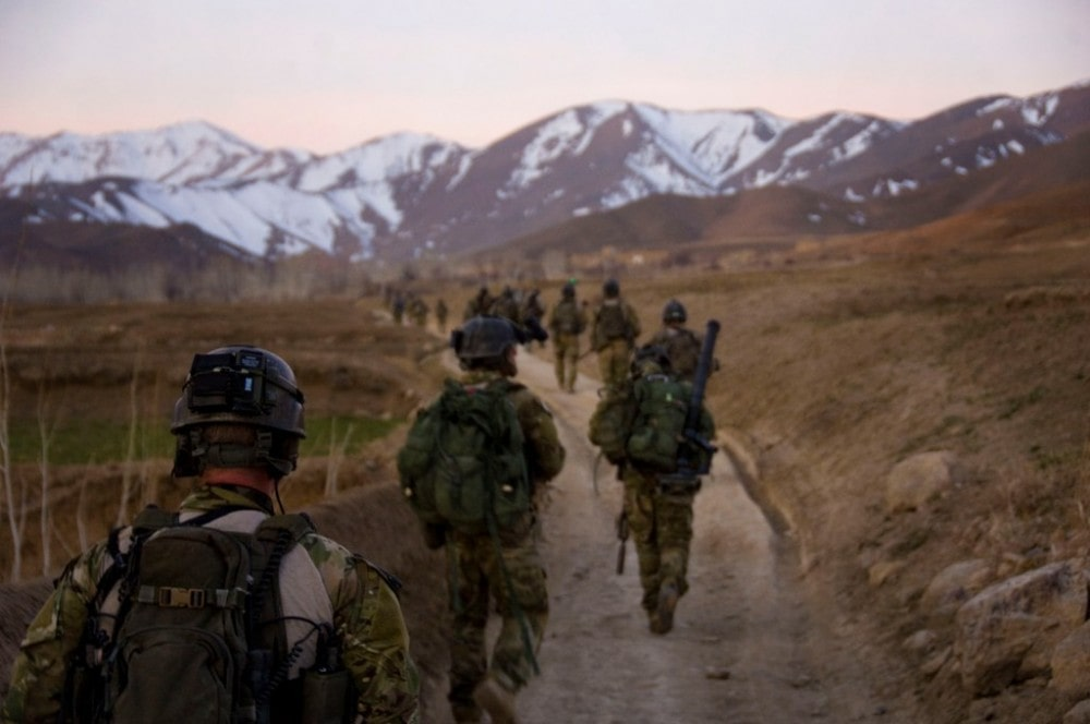 Afghan International Security Force patrol of Army Rangers heads to a compound in the Chak-e Wardak province, March, 2010.