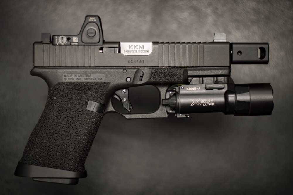 Target acquisition with a red dot sight on a handgun - a red dot optic is just one of several significant features that help make this ATEi Glock a Roland Special.