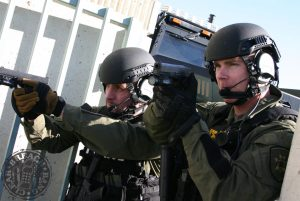 Tactical Officers using offensive handguns (Glock 22s) during building clearing exercise
