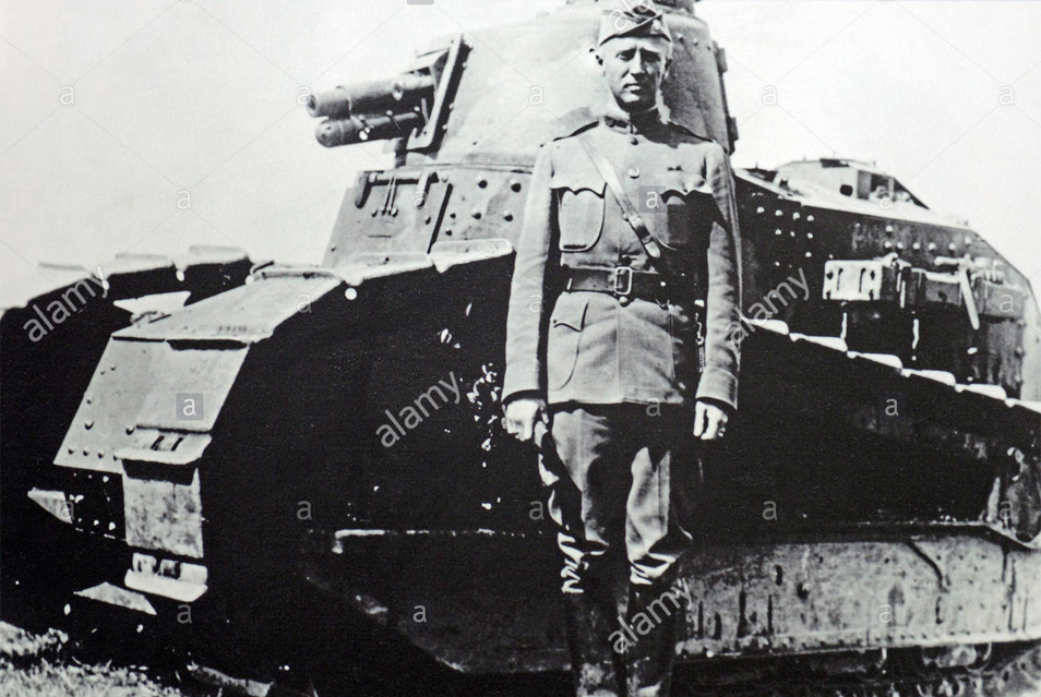 A young Patton standing next to one of his tanks around 1917-18. Photo credit: alamy.com.