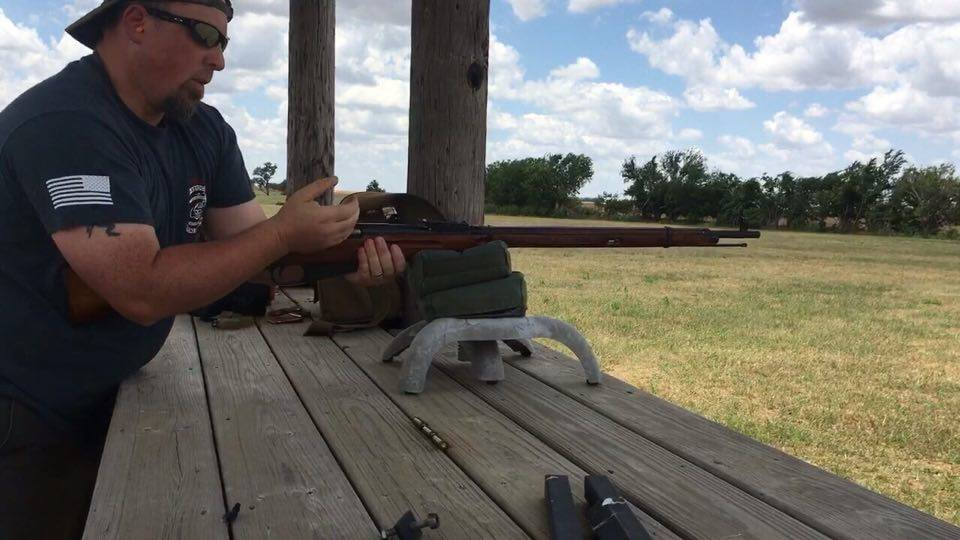 Working the Mosin-Nagant bolt.