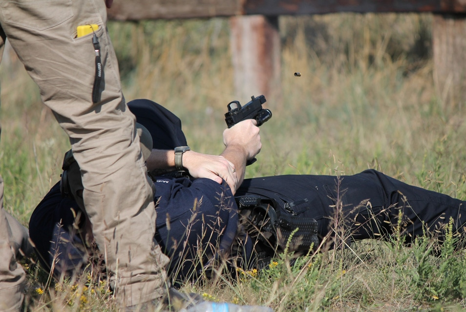 Shooting from alternate positions with an MRDS handgun; in this case, down, on the back, as though wounded.