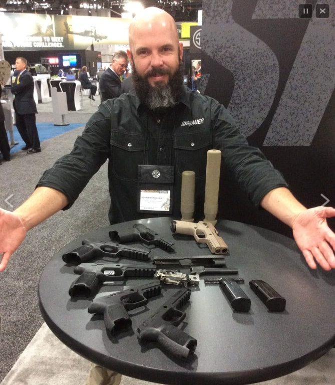 Kevin Brittingham of SIG-Sauer at AUSA 2014 explaining the SIG MHS candidate to Eric Graves of Soldier Systems Daily
