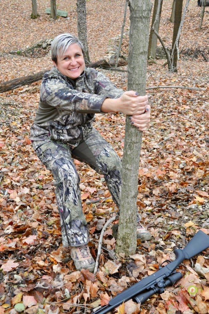 Michelle Cerino demonstrates the Hug a Tree to Pee technique. This is one of several positions women can use when they need to pee in the woods while hunting, or any other place where a lavatory isn't available.
