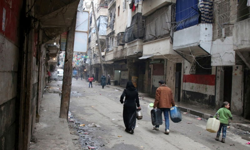 Water is one of the casualties of the Syrian war. Citizens of Aleppo must carry water to their homes in containers.