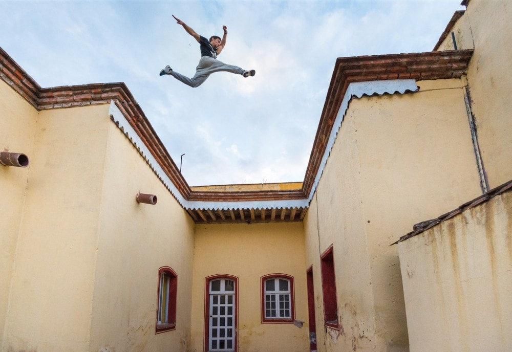 Image of Parkour jump. Man hobby