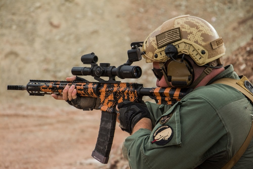 KE Arms' Russell Phagan, competing in the Trooper Armored Division, engages the spinner off hand with his KE-15 Shooting Team Rifle in Gila Monster Cerakote by We Plead the 2nd, with Vortex Viper PST 1-6X at the Hard as Hell Heroes 2 gun match, Southern Utah Practical Shooting Range.