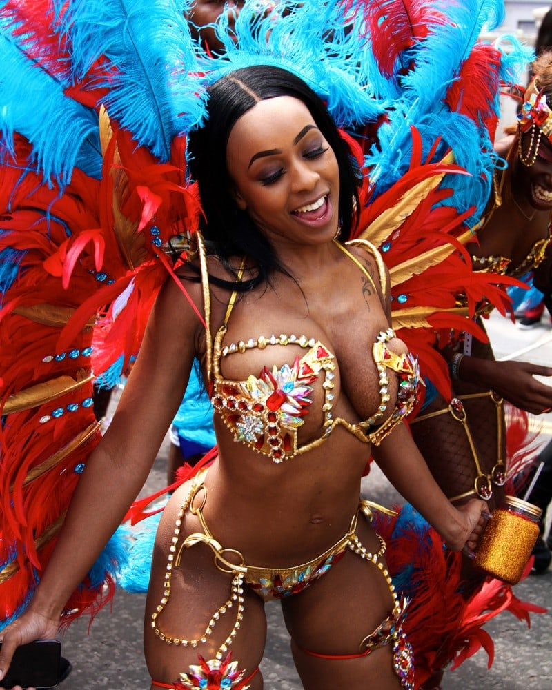 A dancer in the Caribbean with wonderful cleavage during a rum festival.