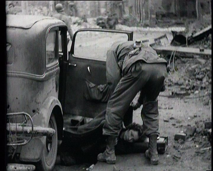 A civilian casualty of the 3rd Armored Divisions advance into Cologne.