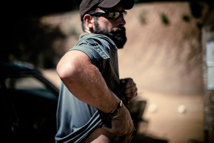 Gripstop inventor Nate Murr on the range with Graham Combat from an article on firearms and risk assessement by Acuto Concepts founder Aaron Haskins