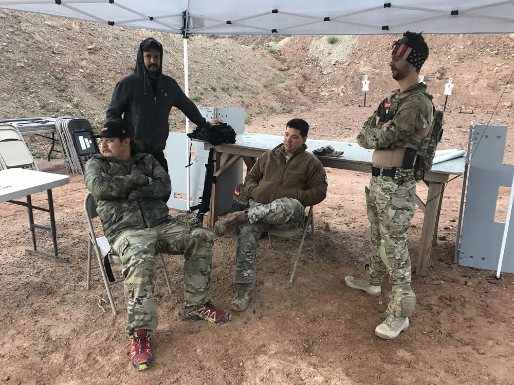 "Competitors from ""We Plead the Second"" awaiting the start of the Rifle Dynamics Red Oktober AK-centric shooting competition."