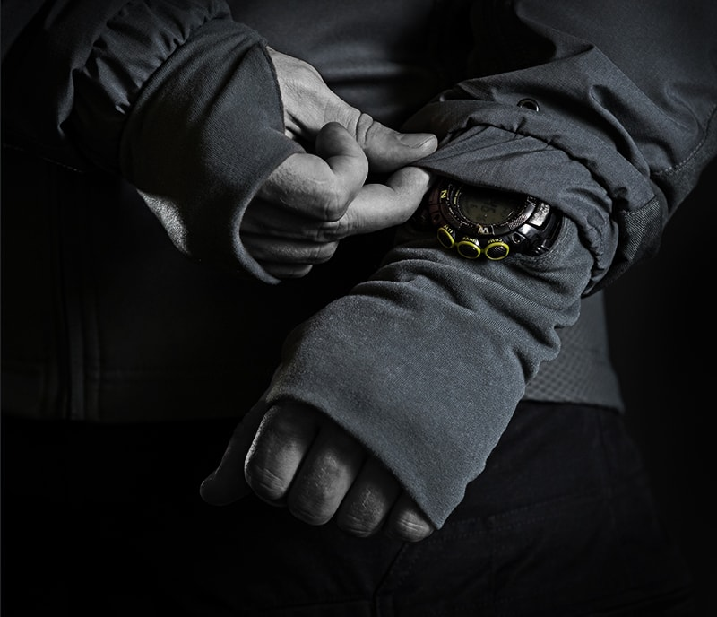 A watch peek-through feature on the new UF PRO Delta AcE Plus Gen.2 Tactical Jacket with the AirPac system. It's high end tactical cold weather gear.