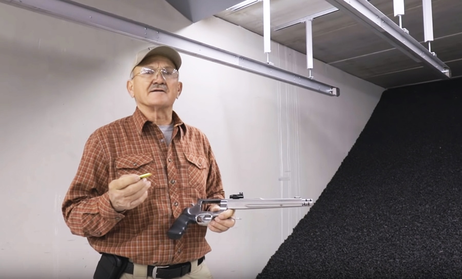 Jerry Miculek, a Propper brand ambassador, splitting a phone in half with a 460 revolver