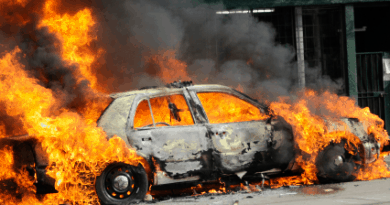 A police car burns after massive civil unrest.