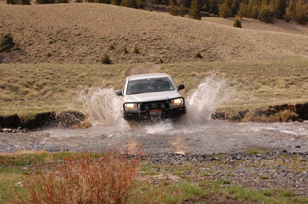 Crossing a swollen creek whilst overlanding
