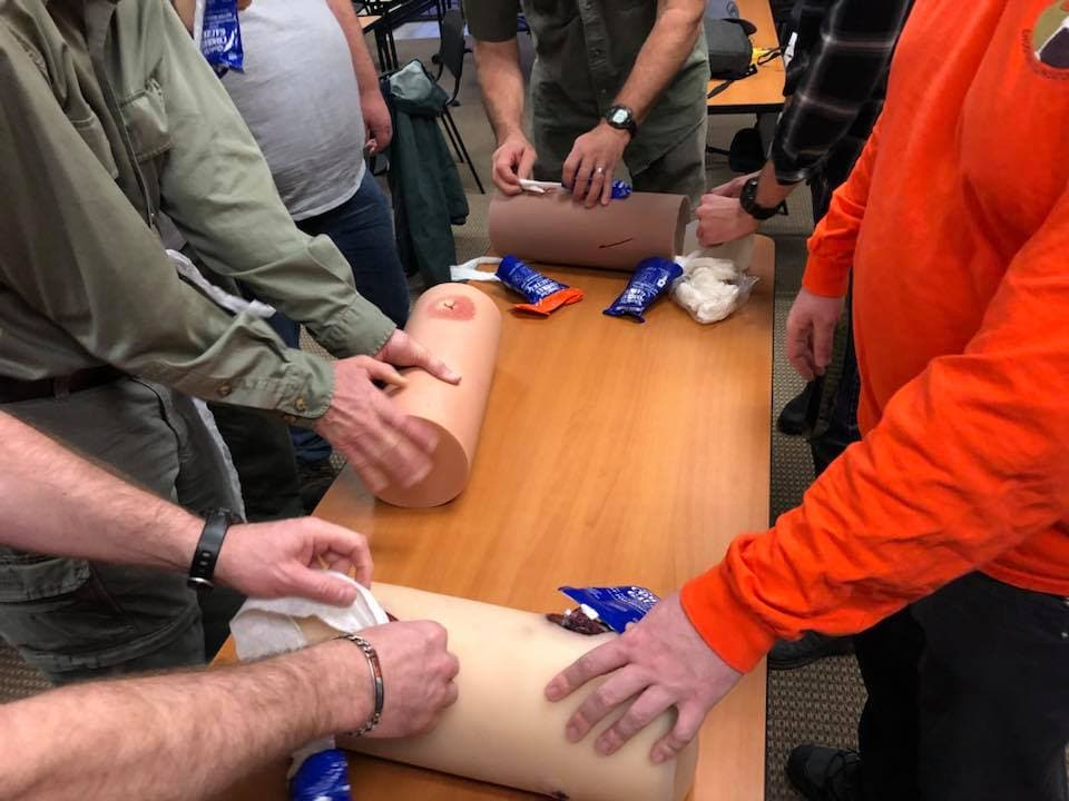 Lone Star Medics class attendees practice addressing different sizes and shapes of wounds.