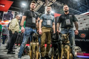 Baden K9 service dogs with their trainers at 2019 SHOT Show.