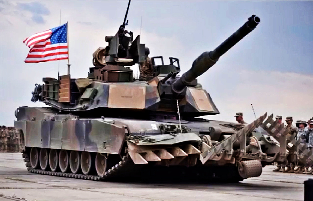 M1 Abrams with a US flag - feature image for Military Slang, tanker terms.