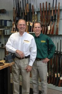 Pete and Frank Brownell in the company firearm library.