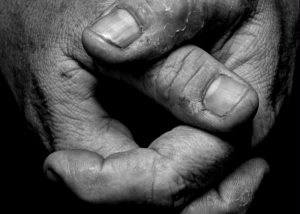 Manning: Image of working man's hands