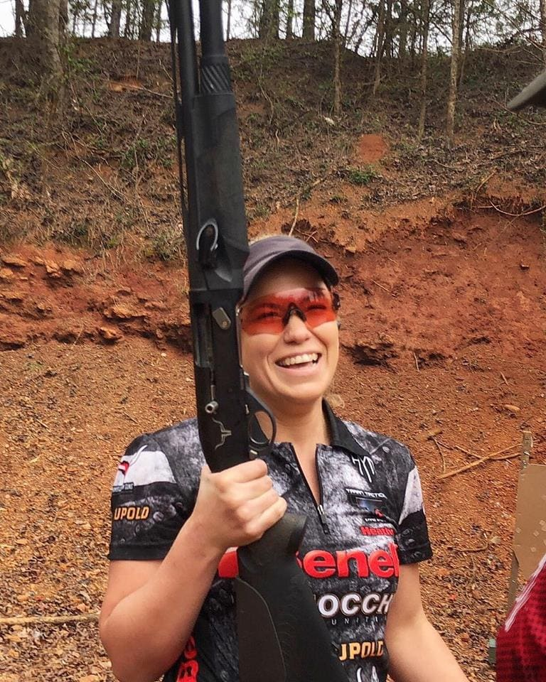 Champion shooters: Showing her sense of humor at a shotgun competition at a 3 gun match