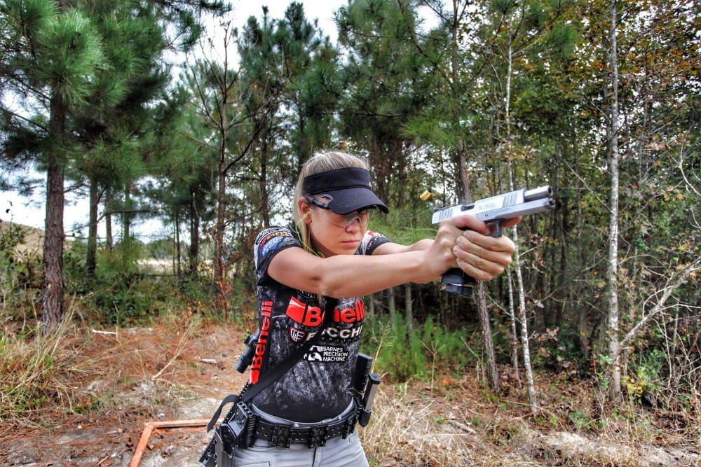 Heather Miller shooting the Hayes Custom Guns optimized SPS Pantera in 9mm - this is from a few years back, but we think it's a great picture, so deal with it.