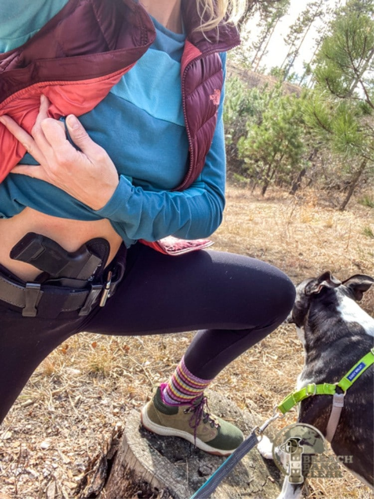 Sara Liberte modeling women's conceal carry pants on a hike.
