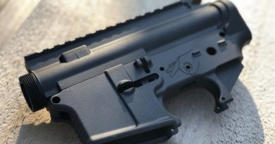 "AR lower with ""meatgazer"" symbol for fire control group"