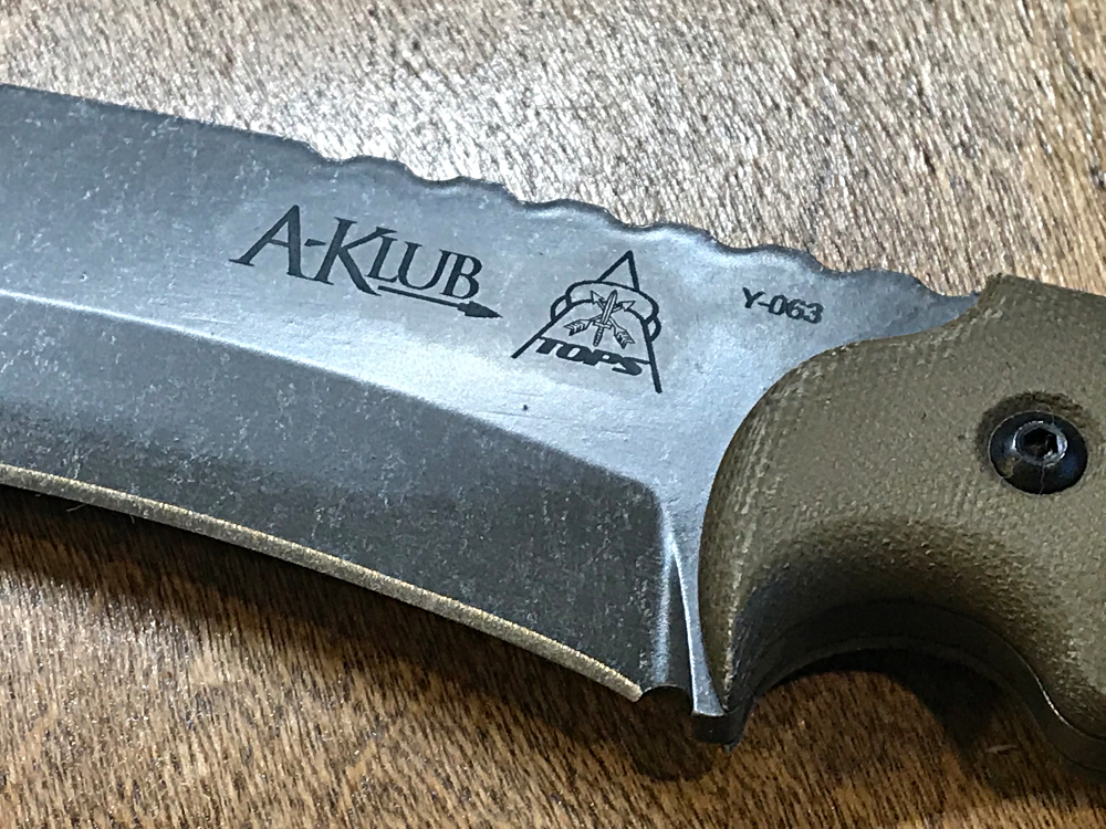 Closeup of the engraving on the blade of the A-Klub.