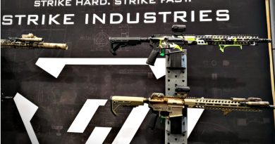 Sentinel Elite Rifles on the wall at the Strike Industries boot.