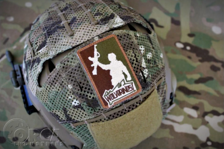 wolverines morale patch on helmet cover.
