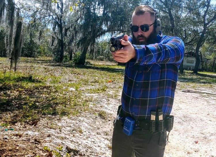Travis Pike demonstrating the fit and functionality of Dixxon's tactical flannel shirts.