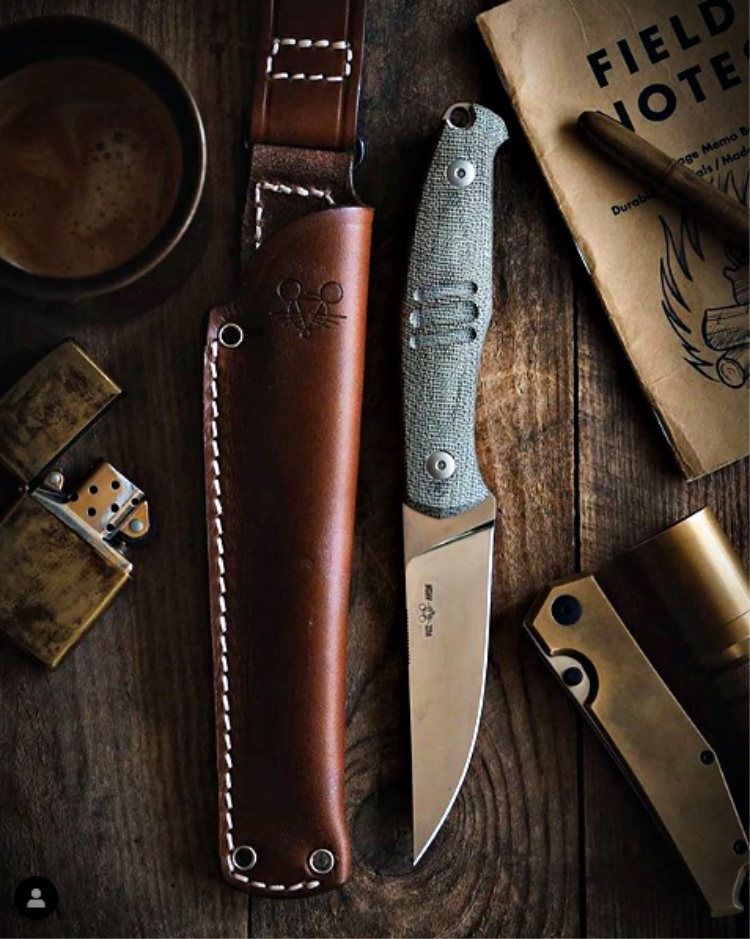"GM says it ""Screams tool, feels cool."" The GMF2-FF features M390 steel, full flat grind, micarta handle and a leather sheath that is a piece of art on it's own"