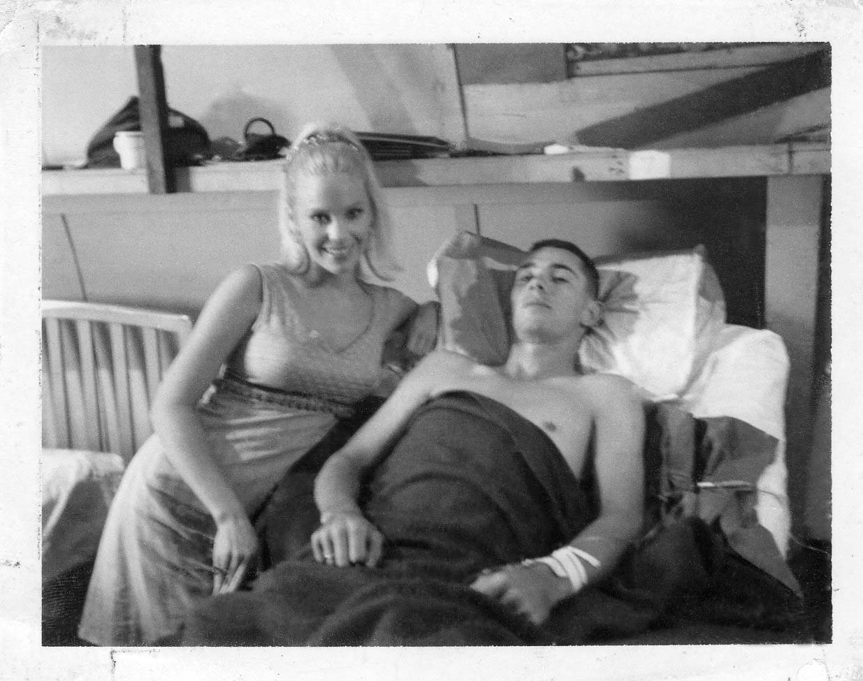 Dennis Fisher with visiting USO girl Mary Grover after being wounded