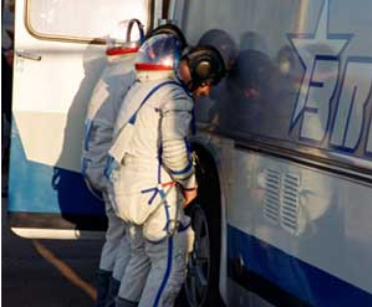 Per tradition, cosmonauts relieve themselves on the right rear tire before entering the transport bus.