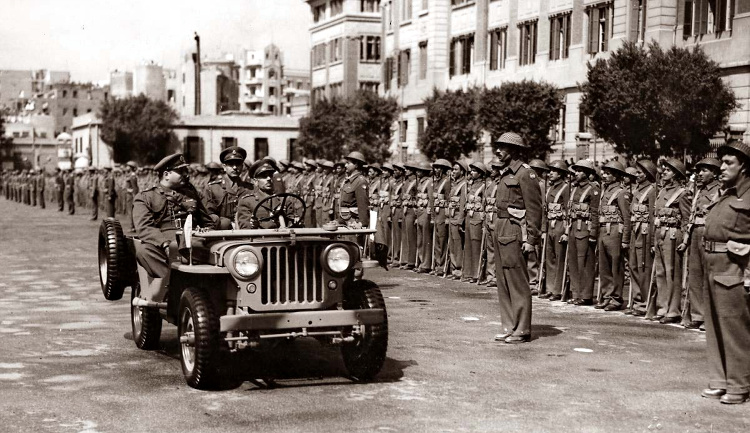 "King Farouk I of Egypt inspecting army units in Abdeen Square in the early 1950s. The Egyptian Army looks rather ""British"" and is still armed with a mix of British Lee Enfield and German Mauser bolt action rifles."