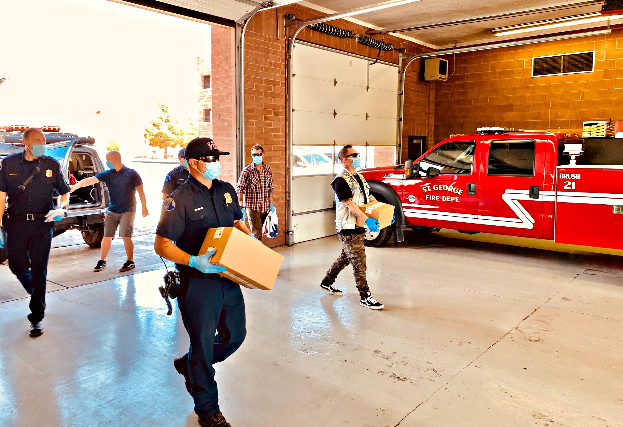 Steineckert delivers PPE kits to the St. George Fire Department.