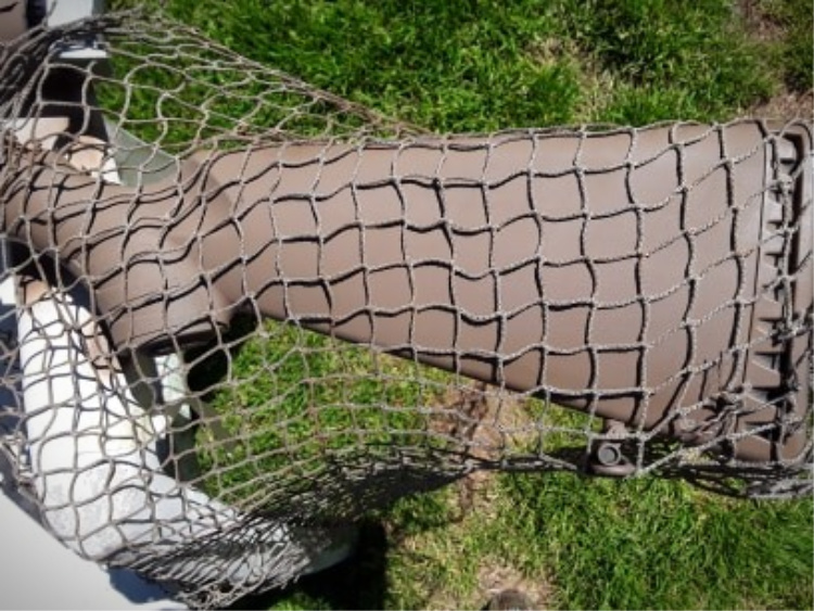 Netting can be laid over the stock in preparation for paint.