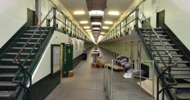 The front view of a prison cell block with 400 cells.