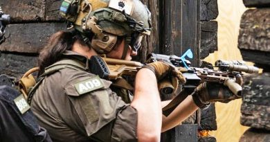 MAWL-, Surefire Scout-, Aimpoint Acro-, and Elcan SpectreDR equipped HK461 in training.