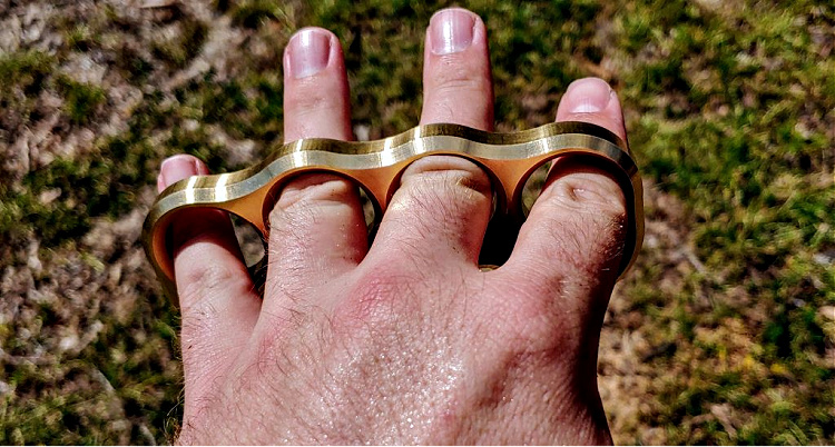 Empire Tactical brass knuckles on the open hand.