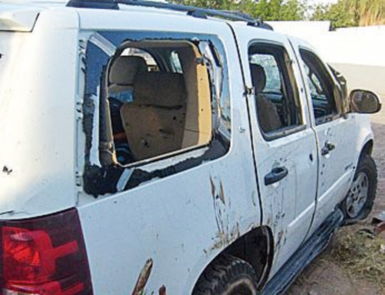 sicario gunfight over border towns. image of vehicle with windows shot out.