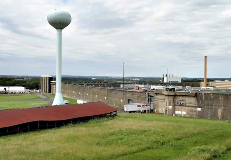 A view of the prison, gun towers can be seen.