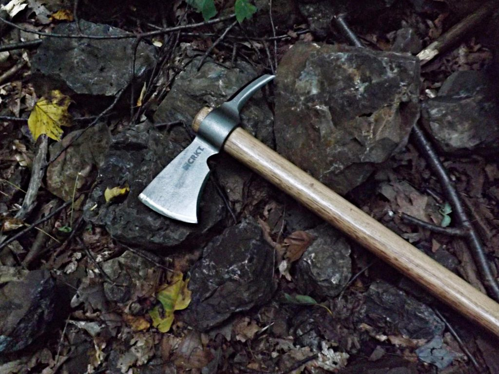 The CRKT Woods Kangee Hawk amid pieces of jasper in a mining hole that was dug by Native Americans, Jasper Park, PA.