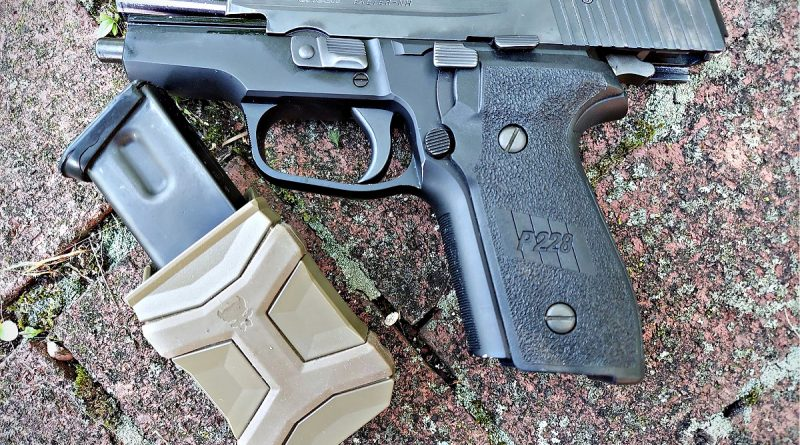 Pitbull Tactical Universal Magazine Carriers easily accommodate double stack mags from the Sig P228.